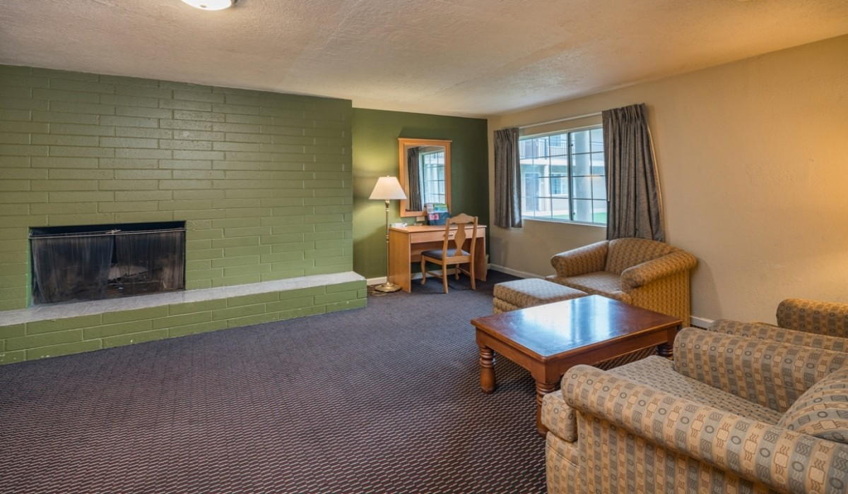 Hotel Rose Garden San Jose - Get Cozy with our fireplace
